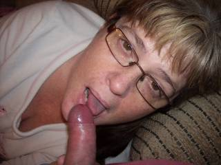 Love you wearing your glasses while you lick his stiff cock.