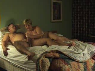 Wife in hotel giving one of her great BJs as her tits bounce around please twell us if you like