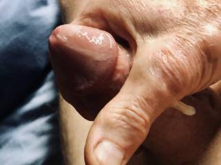 My hand covered in cum after masturbating.