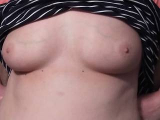 Wife, not wearing a bra, flashing me her gorgeous tits.