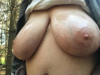 Angled view of oiled big tits outdoors