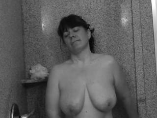 Relaxing and enjoying a hot shower.  Anyone else like to shower with me?  Or shower me with some hot cum?