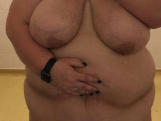 Flashing her tits and fat belly at work