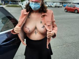 Socially aware Sally wearing her face covering... Didn\'t mean that her tits were covered in the car park as she tried on a new jacket!