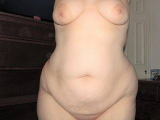 My wife showing off her large tits and smooth voluptuous contours, who\'d like to feel how soft and squeezable she is?