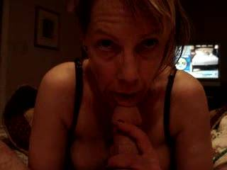Certainly a lot more interesting that the TV news in the background. Love to feel your hot mouth around my cock, Di