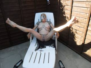 hi me doing what hubby likes me doing laid back legs wide open for your pleasure, comments please mature couple