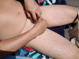 Just a bit of stroking in the noonday sunshine. Hot weather makes me horny. I love being nude outdoors. I love outdoor sex with other people.