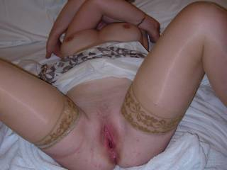 Looks so horny, stockings sexy body and having been well fucked. So wish I was there enjoying th view like a fly on the wall. Very sexy!