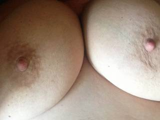kiss, kiss, lick, lick, flick (with tongue), tweak with my fingers, nibble with my teeth, while I am pounding that pussy, then a little stiff dick between the boobs. anything else you would like?