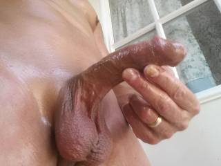 Happens to me too...just something about the feel of warm oil lubed all over cock can't help but glide my hands along the throbbing shaft and cum all over...Great pic of that awesome hot rod!