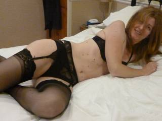 relaxing in black lingerie with stockings
