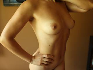 I love her perfect tits and nipples. She works out hard for her sexy body. She loves sexy comments. Thanks