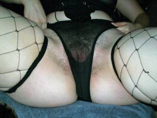 I love when you can see her hairy pussy through her wet panties.