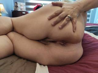 Put your nose right in there, and lick those married holes. Slip your cock in and fuck me in front of Hubby. Cum all over my wedding ring to show him you are my bull.