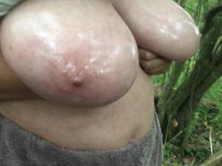 After the previous video, my friend keeps her hands under her big oiled tits and now jiggles them up and down