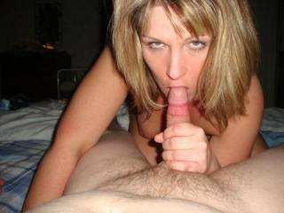 so do i and i wish i was there to watch or have here doing that to me or giving me that look. thx for sharing great picture btw and nice trimmed cock as well.