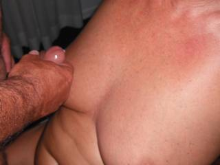 Our overseas swinger friend cums over my tits, when we met up last weekend for a threesome.