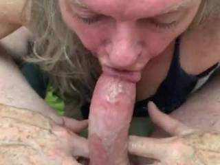 Loving on one of my cocks,  long deep throat strokes, lots of throat slobber running all down the cock, i love to lick it all back in and spit it back all over the hard shiny cock.