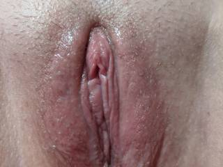 Sally\'s pussy was dripping wet after I\'d licked and fingered her to an amazing orgasm. She was begging me to fuck her hard as I was taking this photo.