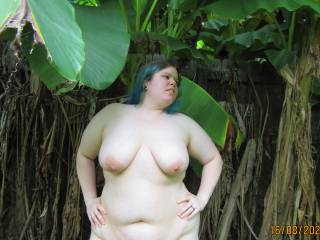 My lovely BBW wife showing off her big soft tits and chubby curves as she poses in the banana trees on our back property. I feel like those bright pink nipples of hers could use some attention, how about you?