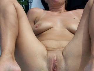 I've said it elsewhere: you have one of the nicest assholes I've seen, woman! I'd love to shove my swollen cock inside that tight hole of yours while you put your feet on my chest ... I would fuck your ass silly ...