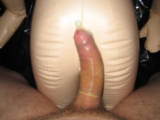 my dick in a condom on a a fuck doll's ass