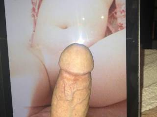 A stranger cocking a pic of my wife's pussy and tits.