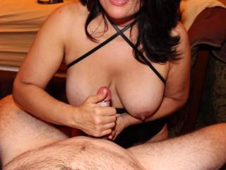 Stroking his cock with purpose...I'm about to get my tits covered in cum!