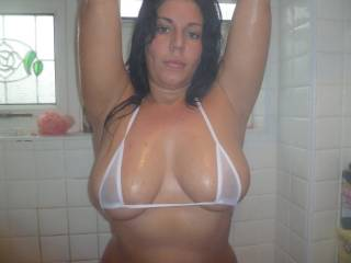 Pretty face and amazing body too, especially those beautiful tits.  Great pic.