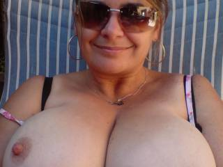 We would love to suck your beautiful tits.  They compliment your pretty face very well.  Very hot pic.