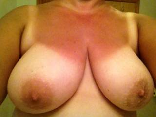 Taking both of your nipples between my fingers, lift your boobs up, sqeese them mmmm they will be so hard. I love to sqeese mine too