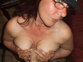 having some fun rubbing his cock between my boobs ...feels good ....does it look good?