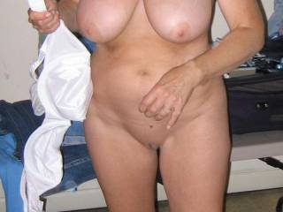 Beautiful tits and a gorgeous, shaved pussy on this lady.  Love the amazing curves too.  Very hot pic.
