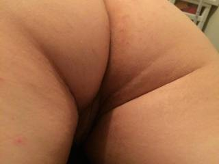 Was taking my pants off to get my dick sucked, but just had to take a min to snap a pic of my wifes nice juicy ass!!! You all like it right?