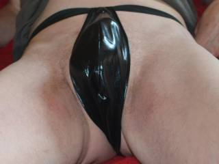 Just about to play in a little wet look pair of thong panties.
