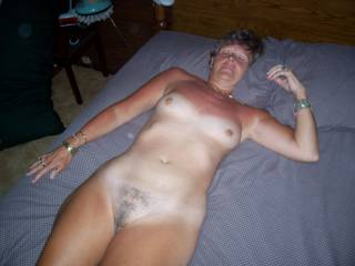 Here\'s my hot mature wife laying naked in bed. She loves having men join her and give her the hard cock that she loves so much. If you found her like this would you fuck her? How would you do it?