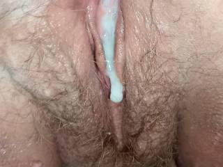 pushing my cum out of her well fucked pussy
