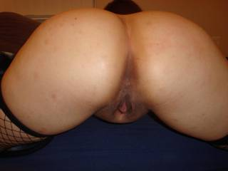 Mmmm that is a nice round ass... I would love to slide my tongue in both those tight lil holes, then DP you with your man...