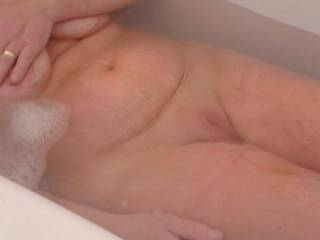 A welcome peek at a fine looking woman. I would love to play with you in or out of the bath.
