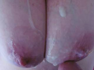 After a tit fuck session, a cum shot on my big tits.
