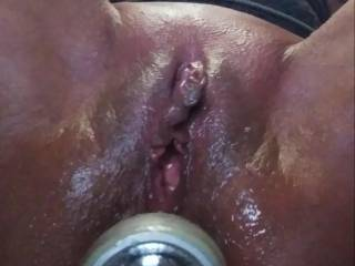 Every time I shave my pussy I get sooooooo horney. So I oiled up my pussy and ass to have a little fun. I have my flashlight in my oily asshole hoping one day it will be a  real cock.