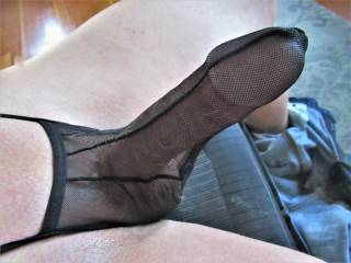 Wearing see-thru undies and getting horny and hard.