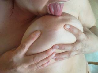 that is so hot-love to see a Lady licking her own nipples