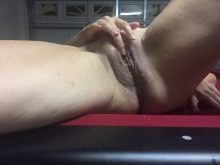 My wife touching her pussy. We did some filthy thing together on that pool table