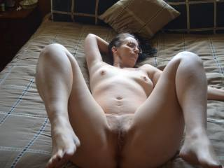 Love the way she's got her hot legs pulled back & spread … ready for cock!