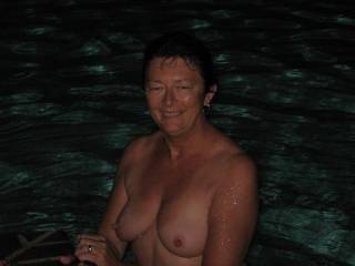 Love to run into beautiful wife in the pool for some late night fun sucking her fantastic nipples getting them so big and hard while waiting for you then both of us giving double barrel cum shots covering those wonderful nipples with hot cream then delighting her more as we both suck them clean and ...