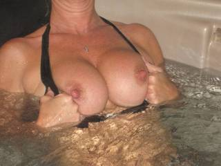 showing her tits in the hot tub..