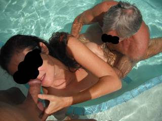 Threesome fun in the swimming pool at home, when our swinger friend came around for a play.