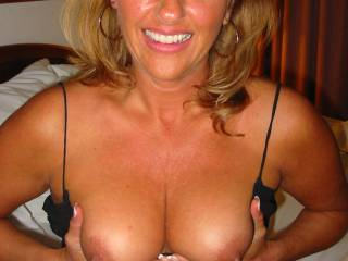 waht a beautiful smile! Gets my attention for sure. And, those tits and nipples are gorgeous; I'd love tobe lickign and sucking htem!
